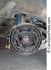Old brake pads and cylinder brake drum