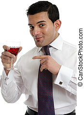 Man recommending wine - A man holding a glass of red wine...