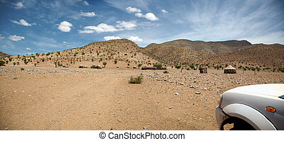 4x4 in the desert of Namibia - Kaokoland - Village in the...