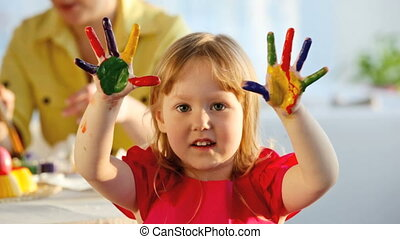 Multicolored fingers - Little girl with fingers and palms...