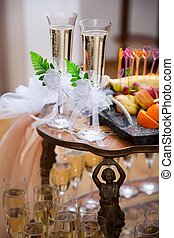 glasses with champagne for groom and bride - decorated...