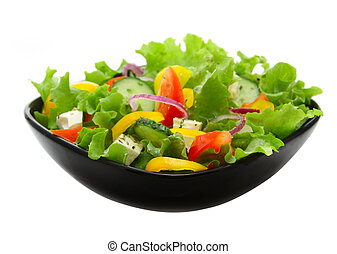 vegetable salad in black square plate over white