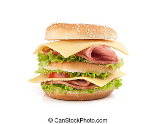 Big appetizing fast food sandwich with lettuce, tomato, ham...