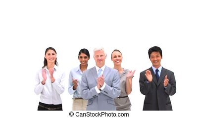 Business team applauding together against a white background