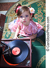Girl in pink with a gramophone. Shooting from the top.