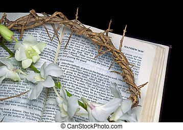 Crown of thorns on Holy Bible - Crown of thorns with orchids...