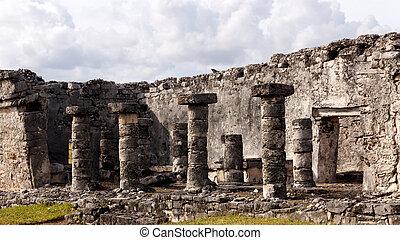Detail of Mayan Ruins at Tulum - Columns line a Mayan ruin...