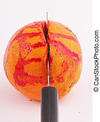 orange - An orange with a knife and traces of blood