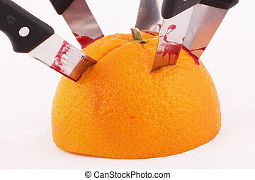 orange - A halved orange with knives