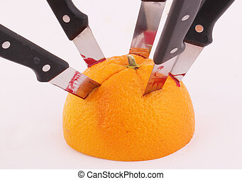 orange - An halved orange with knives