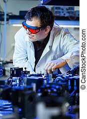 scientist doing research in a quantum optics lab shallow...