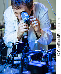 scientist doing research in a quantum optics lab (shallow...