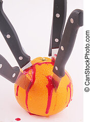 orange - An orange with knives and traces of blood