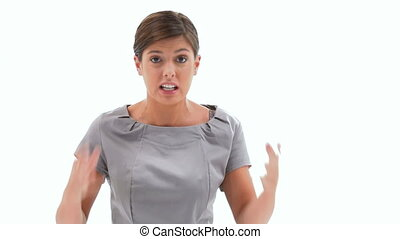 Angry businesswoman shouting to the camera against a white...