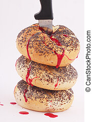 bread rolls - Bread rolls with a knife and traces of blood