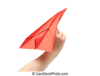 Childs hand launching paper airplane