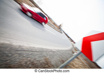 Traffic concept: car driving fast through a sharp turn
