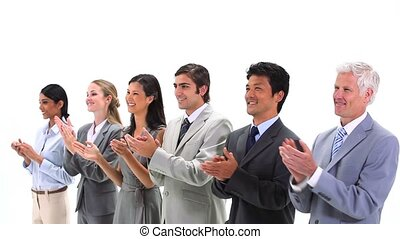Business people standing side by side applauding against a...