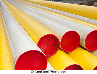 pvc pipes - stacked yellow pvc pipes