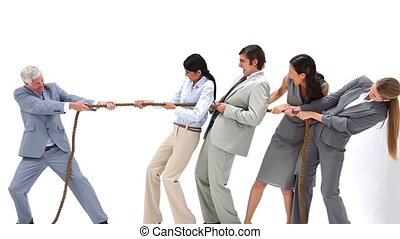 Business team playing Tug-of-War against their boss against...