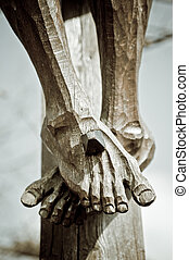 Feet on the Cross - Feet of a wooden jesus christ on the...
