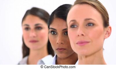 Smiling women looking away against white background
