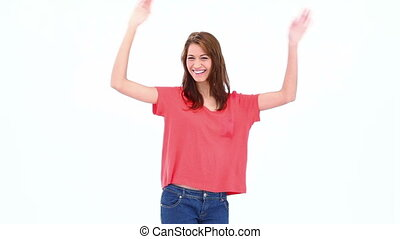Brunette haired woman moving her arms