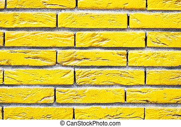 Yellow brick wall closeup