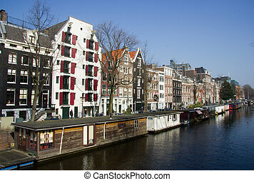 Buildings and boat houses on canal in Amsterdam