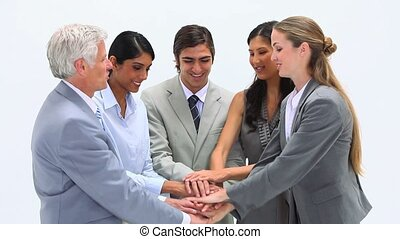 Business team together applauding against a white background