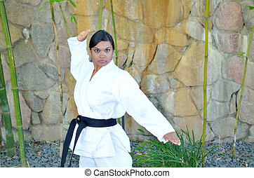 Karate in the park - Woman demonstrating karate in the park