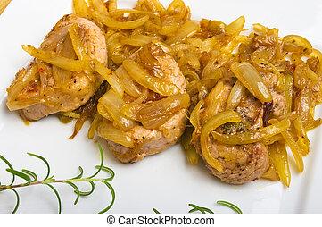 Pork sirloin steaks under onion