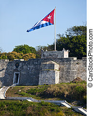 Cuban flag on spanish fortress - Cuban flag waving on...