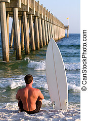 Surfboarder By Pier