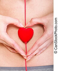 Sexy young woman red heart shape hands belly - Sexy young...