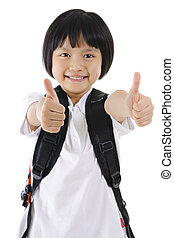 Thumbs up primary school girl with backpack on white...