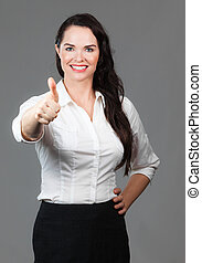 Business woman giving thumbs up - Portrait of successful...