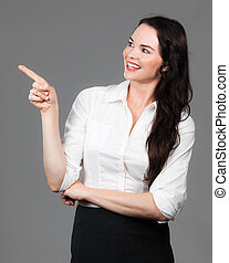 Business woman pointing at copyspace