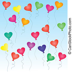 colorful heart-shaped balloons in the blue sky