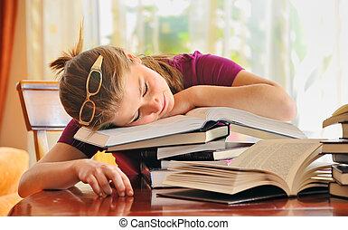 teenager girl sleeping on books