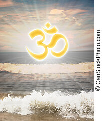 Hindu religious symbol om or aum against sun shine in the...