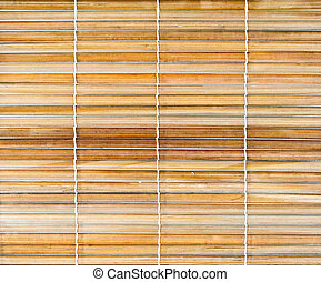Bamboo sticks with thread uniting background