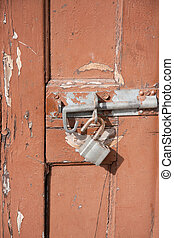Broken lock - old door with a broken lock