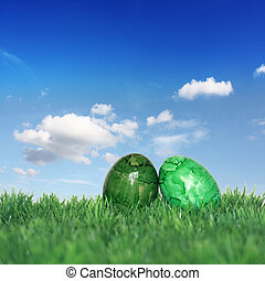 Green Easter eggs on a green meadow