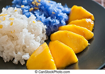 Thai style dessert, glutinous rice eat with mangoes