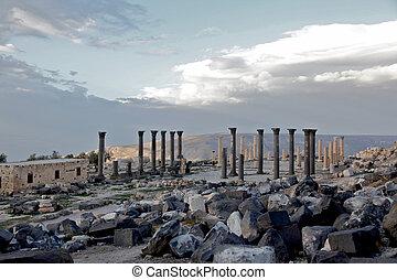 View of Roman Columns & dramatic cloudy Sky - Umm Qais,...