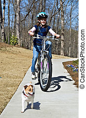 Girl on Bike with Dog