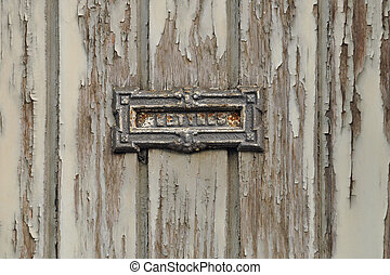 Grungy Letter Box - Vintage grungy letter box on wooden door