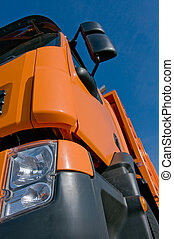 Front of a lorry with blue sky