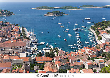 hvar and its harbor - the city of hvar and its harbor at the...